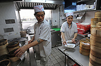 The kitchen of Mak Pui Gor,50, (green shirt)  in Tim Ho Wan the cheapest Michelin starred restaurant in the world, Hong Kong..17-Jul-11..Photo by Richard Jones......