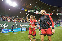 Portland, OR - Saturday, May 21, 2016: Portland Thorns FC midfielder Allie Long (10) and midfielder Tobin Heath (17) wave to the fans after the match. The Portland Thorns FC defeated the Washington Spirit 4-1 during a regular season National Women's Soccer League (NWSL) match at Providence Park.