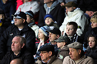 ATTENTION SPORTS PICTURE DESK<br /> Pictured: Swansea City fans in action <br /> Re: Coca Cola Championship, Swansea City Football Club v Nottingham Forest at the Liberty Stadium, Swansea, south Wales. Saturday 12 December 2009