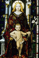Intricate stained glass window of the Madonna and Child in a gallery at the Vatican Museums, Vatican City, Rome, Italy.