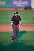 2B Umpire Larry Dilman handles the calls on the bases during the game between the Ogden Raptors and the Grand Junction Rockies at Lindquist Field on September 9, 2019 in Ogden, Utah. (Stephen Smith/Four Seam Images)