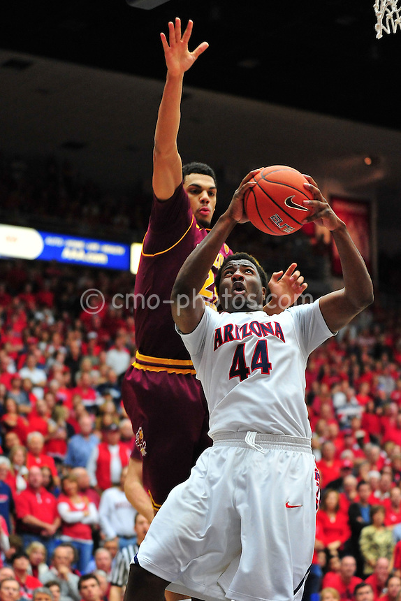 Jan 15, 2011; Tucson, AZ, USA; Arizona State Sun Devils guard Trent Lockett (24) tries to block the shot of Arizona Wildcats forward Solomon Hill (44) in the 2nd half of a game at the McKale Center.  The Wildcats won the game 80-69.