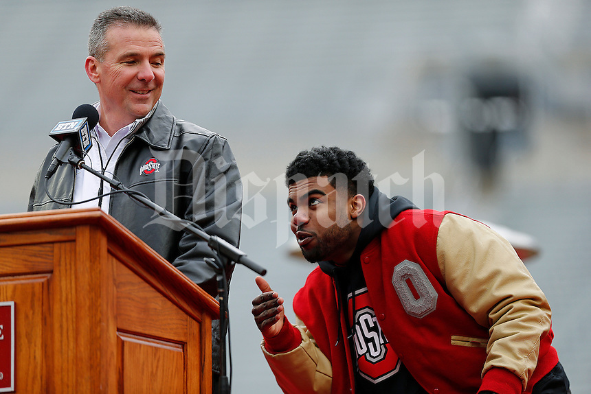 Running back Ezekiel Elliott messes with head coach Urban Meyer as Elliott is called up to the podium during the Ohio State Football National Championship Celebration at Ohio Stadium, Saturday morning, January 24, 2015. More than 40 thousand fans packed the lower stands in the stadium to celebrate the National Championship win with the football team. (The Columbus Dispatch / Eamon Queeney)