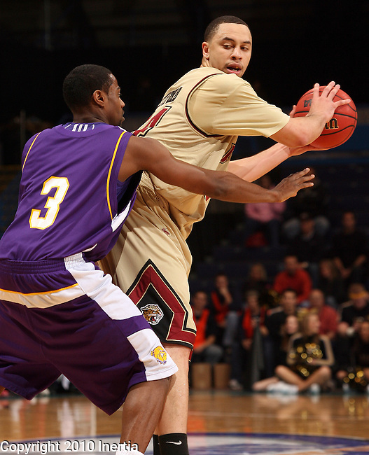 SIOUX FALLS, SD - MARCH 6:   Billy Pettiford #54 of IUPUI controls the ball in front of Tommie Tyler #3 of Western Illinois in the first half of their quarterfinal game at the 2010 Summit League Championship Saturday night at the Sioux Falls Arena in Sioux Falls, SD.  (Photo by Dave Eggen/Inertia)