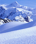 Mount Baker-Snoqualmie National Forest, WA <br /> View of Mt. Shuksan above the wind sculpted snow patterns on Kulshan Ridge near Austin Pass