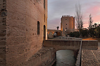 The Molino de San Antonio, a medieval water mill on the Guadalquivir river, Cordoba, Andalusia, Southern Spain. Behind is the Roman bridge, built 1st century BC, and the Torre de la Calahorra, a fortified city gate, built in the 12th century by the Almohads. The historic centre of Cordoba is listed as a UNESCO World Heritage Site. Picture by Manuel Cohen