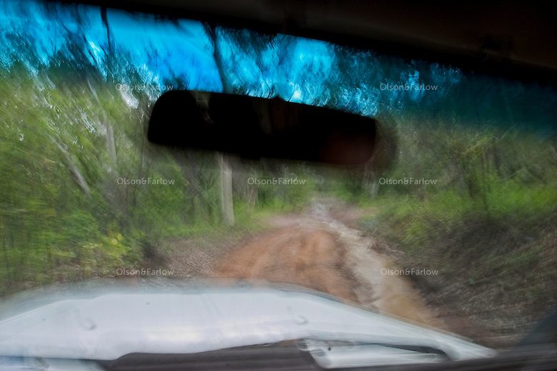 Blur of muddy road when friends 4wheel drive to their favorite spot after a rain.