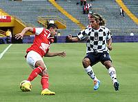 BOGOTA - COLOMBIA -22 -03-2014: Juan Roa (Izq.) jugador de Independiente Santa Fe disputa el balón con Diego Chica (Der.) jugador de Boyaca Chico FC, durante partido por la fecha 12 de la Liga Postobon I-2014, jugado en el estadio Nemesio Camacho El Campin de la ciudad de Bogota. / Juan Roa (L) player of Independiente Santa Fe vies for the ball with Diego Chica (R) player of Boyaca Chico FC during a match for the 12th date of the Liga Postobon I-2014 at the Nemesio Camacho El Campin Stadium in Bogota city, Photo: VizzorImage  / Luis Ramirez / Staff.