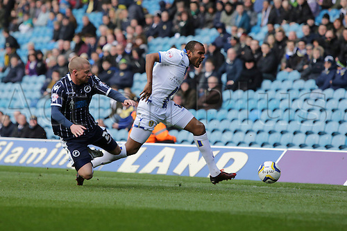 22.03.2014. Leeds,  England. Rodolph Austin and Alan Dunne during the Football FA League Championship game between Leeds United  and Millwall from Elland Road
