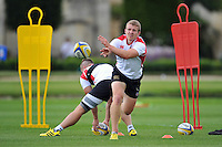 Jonathan Evans of Bath Rugby passes the ball. Bath Rugby training session on September 4, 2015 at Farleigh House in Bath, England. Photo by: Patrick Khachfe / Onside Images