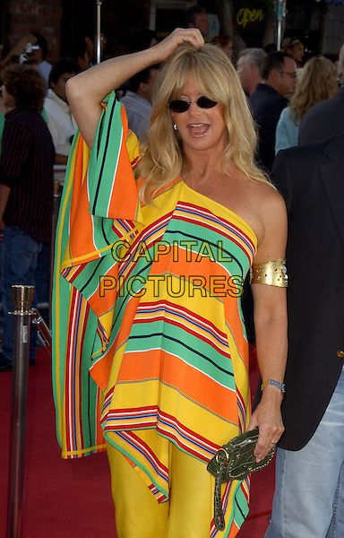"GOLDIE HAWN.World Premiere of ""Dreamer"" held at The Mann Village Theatre in Westwood, California.9th October 2005.Ref: CAP/DVS.three quarter length yellow green red orange poncho shawl off the shoulder trousers gold bangle band jewellery sunglasses shades hand hands on head.www.capitalpictures.com.sales@capitalpictures.com.©Debbie Van Story/Capital Pictures"