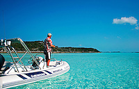 Fly fishing from a small boat in the Exuma Islands, Bahamas. M