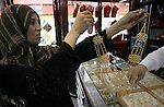 A Palestinian woman looks at gold jewellery at a jewellery store in the Rafah Refugee Camp, Southern Gaza Strip on Sep. 10, 2011. Decline in demand for gold in the Palestinian markets due to the high price of $ 50 per gram, this high price in the global gold. Photo by Abed Rahim Khatib