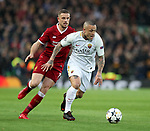 Jordan Henderson of Liverpool chases after Radja Nainggolan of Roma during the Champions League Semi Final 1st Leg match at Anfield Stadium, Liverpool. Picture date: 24th April 2018. Picture credit should read: Simon Bellis/Sportimage