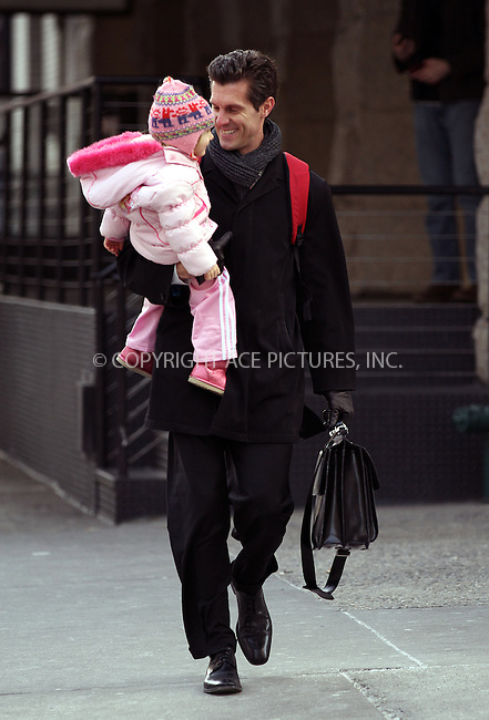 WWW.ACEPIXS.COM....February 4 2013, New York City....Jason Hoppy carries his daughter Bryn in Tribeca on February 4 2013 in New York City....By Line: Zelig Shaul/ACE Pictures......ACE Pictures, Inc...tel: 646 769 0430..Email: info@acepixs.com..www.acepixs.com