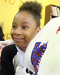 WATERBURY CT. 14 August 2017-081417SV08-Tiara Williams, 8 of Waterbury works on her picture during art class at Kids Club, Greater Waterbury Interfaith Ministries in Waterbury Monday.  <br /> Steven Valenti Republican-American