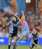 Amber Brooks (12) of the Houston Dash and Sofia Huerta (11) of the Chicago Red Stars both go up for a header at the same time in the first half on Saturday, April 16, 2016 at BBVA Compass Stadium in Houston Texas.