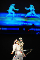 Aug. 9, 2008; Beijing, CHINA; Becca Ward (USA), right, battles Sofiya Velikaya (RUS) in the bronze medal match for the womens fencing individual sabre at the Fencing Hall in the 2008 Beijing Olympic Games. Ward won the match to win the bronze. Mandatory Credit: Mark J. Rebilas-