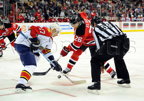 11 December 2009: New Jersey Devils left wing Patrik Elias (26) and Florida Panthers center Steve Reinprecht (27) face off during the second period of the game at Prudential Center in Newark, NJ. Photo by Rich Kane/Actionplus. UK Licenses Only