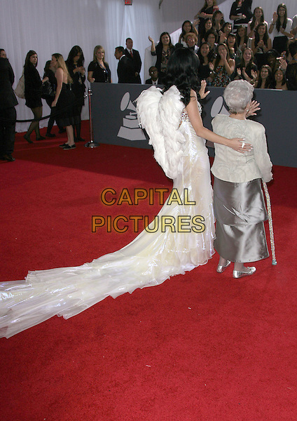 KATY PERRY  & ANN HUDSON .The 53rd Annual GRAMMY Awards held at the Staples Center, Los Angeles, California, USA..February 13th, 2011.arrivals grammys full length white long maxi angel wings dress train shimmery shiny silver beaded cut out embellished platform peep toe shoes family tall short granddaughter family stick cane back behind rear fans crowd audience grandmother Grandma.CAP/ADM.©AdMedia/Capital Pictures.