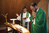 "USA. New York state. Woodbourne. The International Center for a Culture of Compassion (ICCC). The ICCC belongs to the Mouvements catholique Point-Coeurs. Father Alexandre Morard is a swiss citizen and a catholic priest of the Sacerdotal Molokai Fraternity (Fraternité Sacerdotale Molokaï). He celebrates with another priest the morning mass in the house's chapel. The Mass is the Sacrifice of the New Law in which Christ, through the ministry of the priest, offers Himself to God in an unbloody manner under the appearances of bread and wine. The mem­bers of the Sacerdotal ""Molokai"" Fraternity live their priest­hood as a ser­vice to the voca­tion of the lay faithful to holi­ness and according to Heart's Home charism of Compassion. The Society of Apostolic Life ""Molokai"" is gov­erned by its own statutes. It has been placed under the patronage of Father Damien or Saint Damien of Molokai, SS.CC. or Saint Damien de Veuster known as the Apostle of the leper in Molokai (an island in the Hawaiian archipelago). The priests of the Fraternity ""Molokai"" are called to ful­fill sev­eral dif­ferent mis­sions within the Organization Heart's Home as well as at the ser­vice of other eccle­sial real­i­ties. Through their min­istry they try to spread a cul­ture of Compassion throughout the world while being at the ser­vice of all aspects of human life (family, cul­ture, work, pol­i­tics, health) so as to direct them con­stantly to Christ who is the One revealing fully humanity to itself. They con­stantly keep in mind that they are ""use­less ser­vants"" and there­fore avoid to get attached to a role or a func­tion to the detri­ment of the love for Christ and for the people. Gratuitousness and uncon­di­tional care for others are the core of their priestly mis­sion. 4.02.16 © 2016 Didier Ruef"