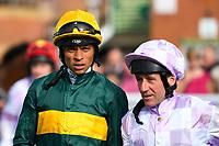 Jockeys Sean Levey and John Egan enter the Parade Ring during Evening Racing at Salisbury Racecourse on 25th May 2019