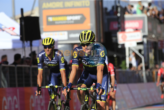 Riders including Chris Juul Jensen (IRL/DEN) Orica-Scott cross the finish line in Tortoli at the end of Stage 2 of the 100th edition of the Giro d'Italia 2017, running 221km from Olbia to Tortoli, Sardinia, Italy. 6th May 2017.<br /> Picture: Eoin Clarke | Cyclefile<br /> <br /> <br /> All photos usage must carry mandatory copyright credit (&copy; Cyclefile | Eoin Clarke)
