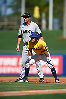 Michigan Wolverines catcher Marcus Chavez (12) leads off first base in front of first baseman John McKenna (21) during a game against Army West Point on February 17, 2018 at Tradition Field in St. Lucie, Florida.  Army defeated Michigan 4-3.  (Mike Janes/Four Seam Images)