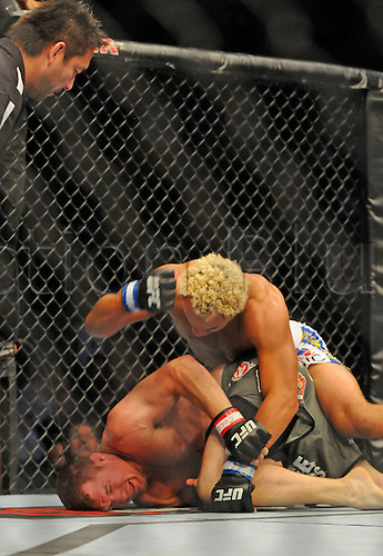 24.09.2011. Denver, Colorado. Josh Koscheck lands the final set of blows on Matt Hughes during UFC 135 at the Pepsi Center in Denver, Colorado.