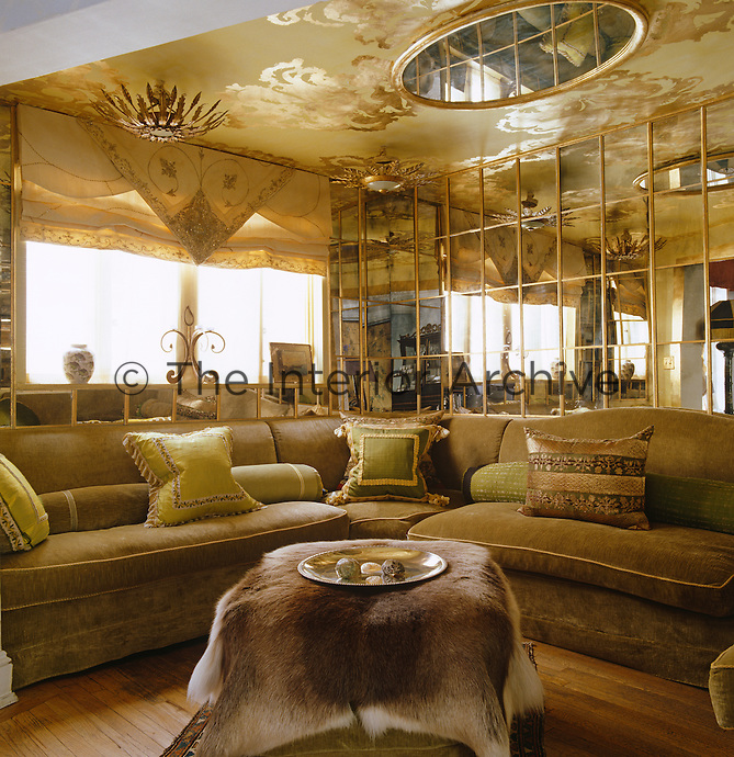 Lined in silvered Venetian mirrors and with a plump velvet banquette, this awkward space at the back of the house has been transformed into an exotic Arabian-style alcove