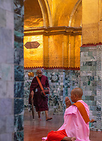 3AM at the cleansing of the Buddha ceremony, the Mahamuni Buddha Temple it is a Buddhist temple and major pilgrimage site, located southwest of Mandalay, Myanmar. The Mahamuni Buddha image is deified in this temple, and originally came from Arakan. Myanmar, Burma,