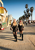 USA, Los Angeles, two women walking down the Venice Boardwalk