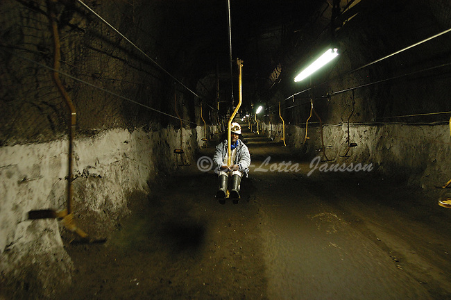 Lebo Molefe sits on what looks and feels, incongruously, very much like a ski lift to reach a chrome section of the mine, about 300 metres below the surface.
