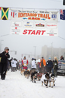 Jan Steves and team leave the ceremonial start line at 4th Avenue and D street in downtown Anchorage during the 2013 Iditarod race. Photo by Jim R. Kohl/IditarodPhotos.com