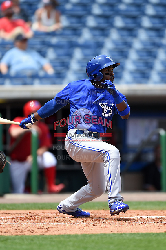 Dunedin Blue Jays outfielder Dwight Smith Jr. (25) hits his second home run off rehabbing Cole Hamels (not pictured) during a game against the Clearwater Threshers on April 6, 2014 at Bright House Field in Clearwater, Florida.  Dunedin defeated Clearwater 5-2 as Smith hit two home runs in his first two at bats.  (Mike Janes/Four Seam Images)