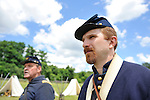 Old Bethpage, New York, USA - July 21, 2012: At left, WILLIAM (BILL) CARMAN of Wantagh, NY, whose great-grandfather, John Carman, was member of Co. H in Civil War, and another rederal re-enactor, portray life in Camp Scott, a Union Army training camp, at Old Bethpage Village Restoration, to commemorate 150th Anniversary of American Civil War, on Saturday, July 21, 2012.