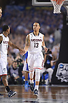 07 April 2014: Shabazz Napier (13) of the University of Connecticut celebrates a score against the University of Kentucky during the 2014 NCAA Men's DI Basketball Final Four Championship at AT&T Stadium in Arlington, TX. Connecticut defeated Kentucky 60-54 to win the national title. Peter Lockley/NCAA Photos
