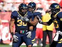 Mychal Kendricks of California gets celebrated by his teammates after making a big play during the game at Candlestick Park in San Francisco, California on September 3rd, 2011.  California defeated Fresno State, 36-21.