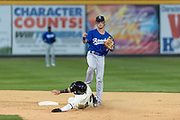 Rancho Cucamonga Quakes second baseman Brandon Montgomery (12) makes a throw to first base over Mark Karaviotis (24) during a California League game against the Visalia Rawhide on April 9, 2019 in Visalia, California. Visalia defeated Rancho Cucamonga 8-5. (Zachary Lucy/Four Seam Images)