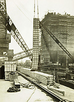 BNPS.co.uk (01202 558833)<br /> Pic: MitchellsAuctionHouse/BNPS<br /> <br /> PICTURED: The construction was built in the dry docks on The Thames and Clyde and pulled across the channel by tugs before being hastily assembled<br /> <br /> The fascinating archive of one of the engineers who designed the Mulberry Harbours which were installed off the Normandy coast following the D-Day landings has come to light.<br /> <br /> Colonel Vassal Charles Steer-Webster OBE helped create the giant, floating artificial harbours which protected anchored supply ships from German attacks.<br /> <br /> They were built in the dry docks on The Thames and Clyde and pulled across the channel by tugs before being hastily assembled.<br /> <br /> Col Steer-Webster was in almost daily contact with Churchill during their development ahead of June 6, 1944. Now, his personal effects, including a letter of thanks from Winston Churchill, are being sold by his nephew with Mitchells Auctioneers, of Cockermouth, Cumbria. <br /> <br /> The archive, which is expected to fetch £15,000, also features 150 photos showing Mulberry B's construction and use, as well as his medals.