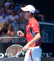 KEI NISHIKORI (JPN ) against JO-WILFRED TSONGA (FRA) in the fourth round of the Men's Singles. Kei Nishikori  beat Jo-Wilfred Tsonga 2-6 6-2 6-1 3-6 6-3..23/01/2012, 23rd January 2012, 23.01.2012 - Day 8..The Australian Open, Melbourne Park, Melbourne,Victoria, Australia.@AMN IMAGES, Frey, Advantage Media Network, 30, Cleveland Street, London, W1T 4JD .Tel - +44 208 947 0100..email - mfrey@advantagemedianet.com..www.amnimages.photoshelter.com.