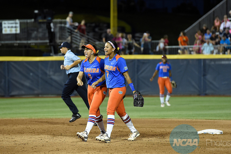 02 JUNE 2014:   Katie Medina (6) and Kelsey Stewart (7) of the University of Florida celebrate after turning a double play against the University of Alabama during the Division I Women's Softball Championship held at ASA Hall of Fame Stadium in Oklahoma City, OK.  Florida defeated Alabama 5-0 in Game One.  Jamie Schwaberow/NCAA Photos