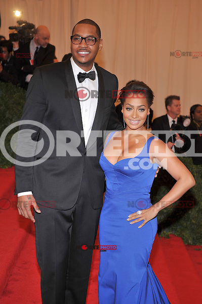 Carmelo Anthony and Lala Anthony at the 'Schiaparelli And Prada: Impossible Conversations' Costume Institute Gala at the Metropolitan Museum of Art on May 7, 2012 in New York City. ©mpi03/MediaPunch Inc.