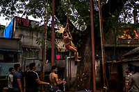 Kushti wrestlers train on the ropes at Gangavesh Talim on the 18th of September, 2017 in Kolhapur, India.  <br /> Photo Daniel Berehulak for Lumix