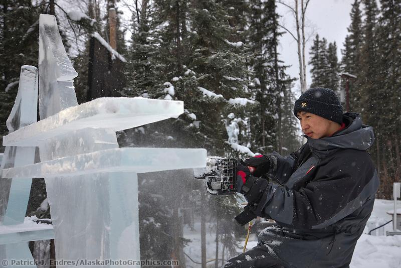 "Mongolian sculptors Dorjsuren Lkhagvadorj and Munkh-Erdene Tsagaan work on the abstract single block sculpture titled ""Ice Tomography"" for the 2009 World Ice Art Championships in Fairbanks, Alaska."