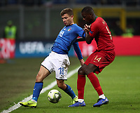 Football: Uefa Nations League Group 3match Italy vs Portugal at Giuseppe Meazza (San Siro) stadium in Milan, on November 17, 2018.<br /> Italy's Niccol&ograve; Barella (l) in action with Portugal's Luis Neto (r) during the Uefa Nations League match between Italy and Portugal at Giuseppe Meazza (San Siro) stadium in Milan, on November 17, 2018.<br /> UPDATE IMAGES PRESS/Isabella Bonotto<br /> <br /> UPDATE IMAGES PRESS/Isabella Bonotto