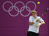 Denis Istomin - Russia..Tennis - OLympic Games -Olympic Tennis -  London 2012 -  Wimbledon - AELTC - The All England Club - London - Saturday 28th June  2012. .© AMN Images, 30, Cleveland Street, London, W1T 4JD.Tel - +44 20 7907 6387.mfrey@advantagemedianet.com.www.amnimages.photoshelter.com.www.advantagemedianet.com.www.tennishead.net