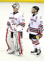 Nebraska Omaha goalie John Faulkner and Matt White. (Photo by Michelle Bishop) .