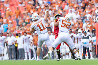 Landover, MD - September 1, 2018: Texas Longhorns quarterback Sam Ehlinger (11) throws the ball down field from the pocket created by Texas Longhorns offensive lineman Samuel Cosmi (52) during game between Maryland and No. 23 ranked Texas at FedEx Field in Landover, MD. The Terrapins upset the Longhorns in back to back season openers with a 34-29 win. (Photo by Phillip Peters/Media Images International)