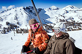 USA, Utah, two smiling women skiers on the Supreme Chairlift, Alta Ski Resort